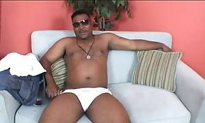 Hot black dude who`s heavy-set and has a long thick pole inside his pants.