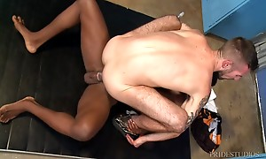 Pheonix is stretching on a mat in the locker room getting re...
