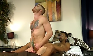 Bennett lies on his back while Jay gets a turn to service hi...