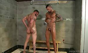 Derek is lathered up in soap giving Dolf a sexy stare down a...